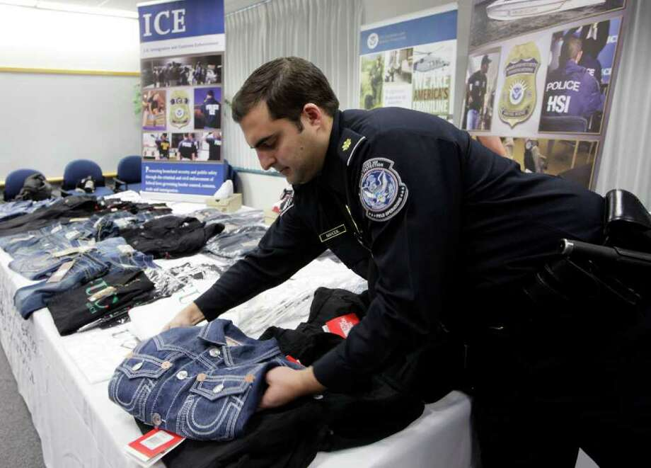 Some of the counterfeit goods seized by federal agencies in Operation Holiday Hoax II are displayed in Los Angeles by Immigration and Customs Enforcement agents. The operation rounded up a total of $76.8 million worth of items. Photo: NICK UT, ASSOCIATED PRESS