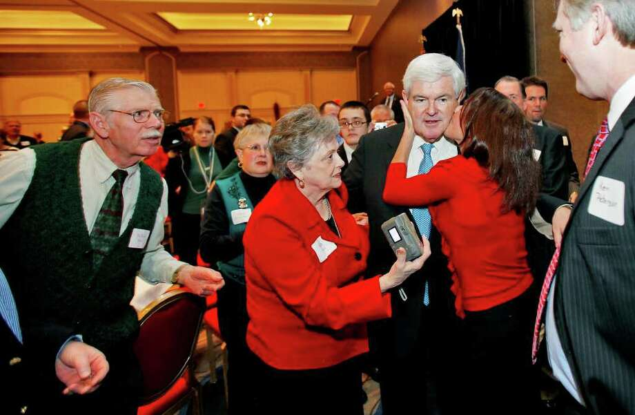 Former House Speaker and current presidential candidate Newt Gingrich is surrounded by supporters after speaking at a Virginia GOP fundraiser in Henrico County, just outside of Richmond, Va., Thursday, Dec. 22, 2011. (AP Photo/Richmond Times-Dispatch, Mark Gormus) Photo: Mark Gormus