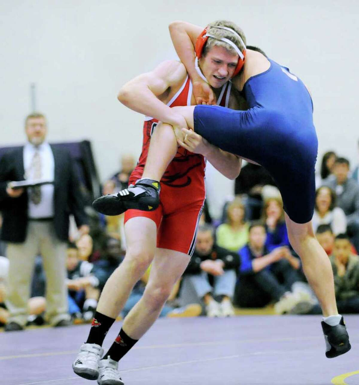 At left, Mike Gestal of Greenwich High School, mixes it up with Andrew Sakamoto of Wilton High School in the 138 pound weight class in high school wrestling match between Greenwich High School and Wilton High School at Westhill High School in Stamford, Thursday night, Dec. 22, 2011.