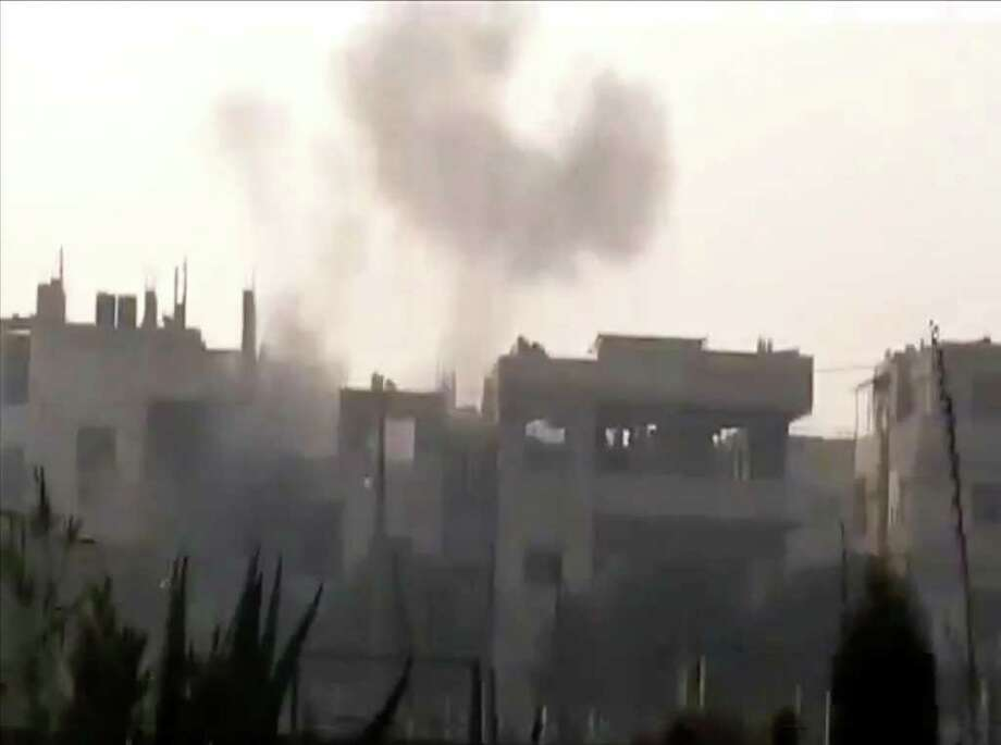 This image made from amateur video and made available by Shaam News Network Thursday Dec. 22, 2011, purports to show smoke clouds after heavy shelling in Homs, Syria. Fresh raids and gunfire by government forces on Thursday killed at least 19 people, most of them in the central city of Homs and northern Idlib province, according to the British-based Syrian Observatory for Human Rights and the Local Coordination Committees. (AP Photo/Shaam News Network via APTN) THE ASSOCIATED PRESS CANNOT INDEPENDENTLY VERIFY THE CONTENT, DATE, LOCATION OR AUTHENTICITY OF THIS MATERIAL.  TV OUT Photo: Anonymous / Shaam News Network