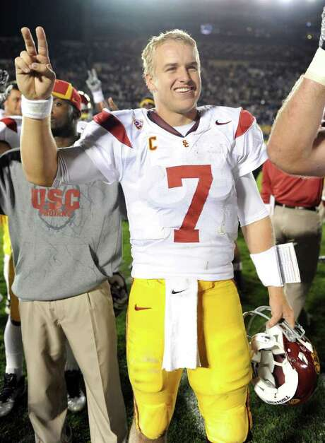 FILE - This Oct. 22, 2011 file photo shows Southern California quarterback Matt Barkley celebrating a 31-17 victory over Notre Dame, in South Bend, Ind. Barkley is set to announce whether he will turn pro or return to school next year. The junior quarterback will hold a news conference Thursday, Dec. 22, 2011 at Heritage Hall on the USC campus. (AP Photo/Joe Raymond, File) Photo: Joe Raymond / Joe R. Raymond