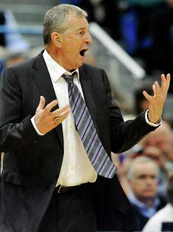 Connecticut head coach Jim Calhoun reacts in the second half of an NCAA college basketball game against Fairfield in Hartford, Conn., Thursday, Dec. 22, 2011. Connecticut defeated in-state rival Fairfield 79-71 in the final game before Calhoun serves a three-game suspension for NCAA recruiting violations. (AP Photo/Jessica Hill) Photo: Jessica Hill/Associated Press / AP2011