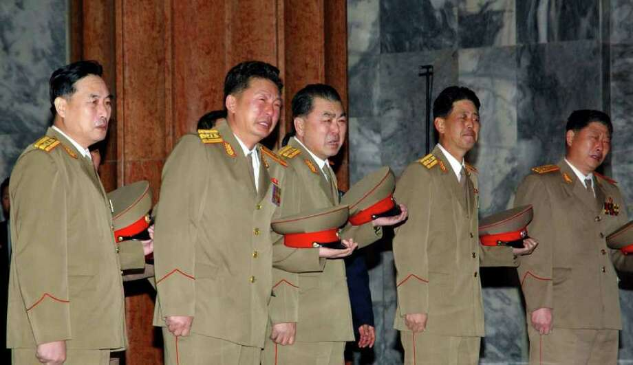 In this Tuesday, Dec. 20, 2011 photo released by the Korean Central News Agency and distributed in Tokyo Thursday, Dec. 22, 2011 by the Korea News Service, North Korean soldiers cry as they pay respects to their leader Kim Jong Il at Kumsusan Memorial Palace in Pyongyang, North Korea. Kim died on Saturday Dec. 17, North Korean state media announced Monday. (AP Photo/Korean Central News Agency via Korea News Service) JAPAN OUT UNTIL 14 DAYS AFTER THE DAY OF TRANSMISSION