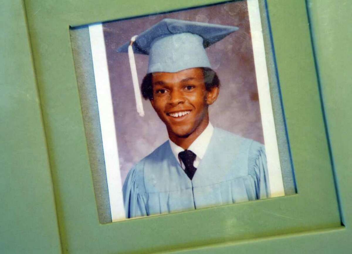 A graduation photo of Timothy Cole is displayed in his family's home.