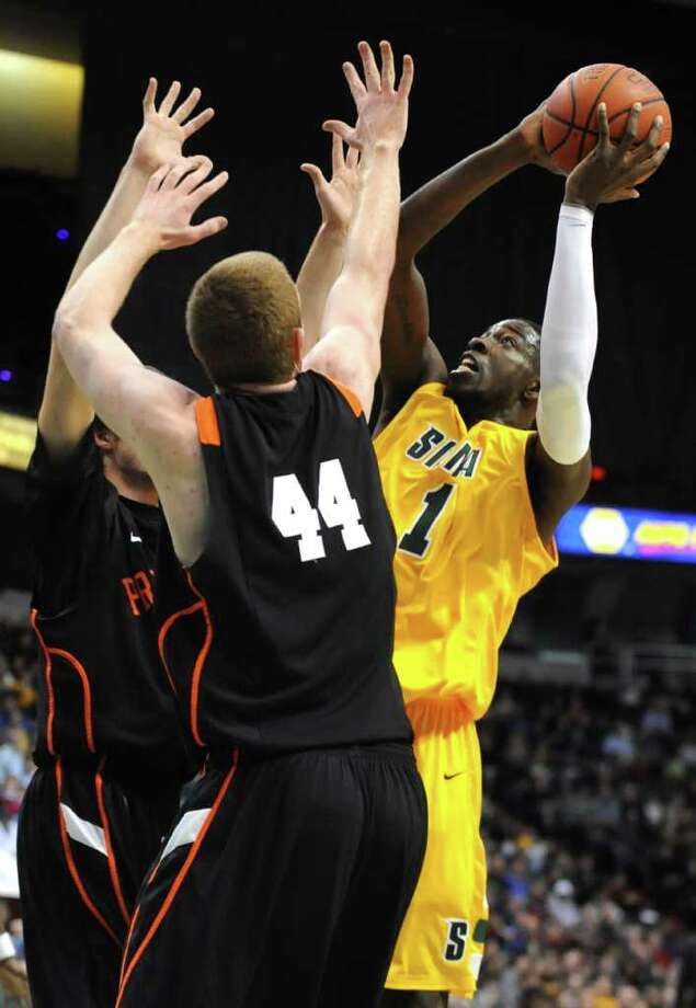 Siena's OD Anosike drives around Princeton's Brendan Connelly during a basketball game on Thursday, Dec. 22, 2011 in Albany, N.Y.  (Lori Van Buren / Times Union) Photo: Lori Van Buren