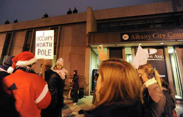 Occupy Albany members gather outside Albany  City Court on Morton Ave. after some members were arrested on Thursday, Dec. 22, 2011 in Albany, N.Y.  (Lori Van Buren / Times Union) Photo: Lori Van Buren