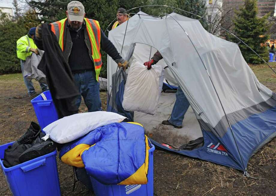 DGS workers take down the last tents of the Occupy Albany movement in Academy Park on Thursday, Dec. 22, 2011 in Albany, N.Y.  (Lori Van Buren / Times Union) Photo: Lori Van Buren
