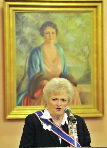 DRT President General Karen Thompson speaks in front of a well-known portrait of Clara Driscoll in this photo from December 2011. Photo: Robin Jerstad, For The Express-News