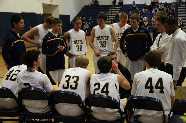 Weston's players listen to coach Mike Hvizdo's instructions during a game. Hvizdo resigned when a controversial short film, in which he performed, came to the attention of Weston administrators. Photo: Justine Seligson / For The Westp