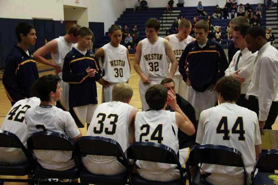 Weston's players listen to coach Mike Hvizdo's instructions during a game.Hvizdo resigned when a controversial short film, in which he performed, came to the attention of Weston administrators. Photo: Justine Seligson / For The Westp