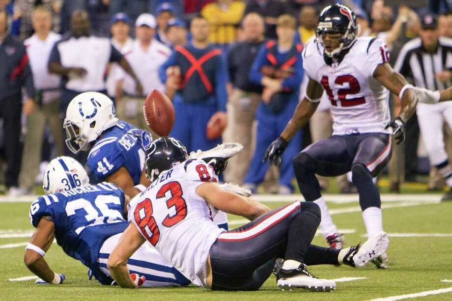 SMILEY N. POOL: Chronicle  FOLLOW THE BOUNCING BALL: Jacoby Jones (12) was rewarded for keeping his eyes on the prize, eventually scooping up a pass intended for Kevin Walter (83) that deflected off a Colts defender late in the fourth quarter and turning it into the Texans' first third-down conversion of game. Photo: Smiley N. Pool / © 2011  Houston Chronicle