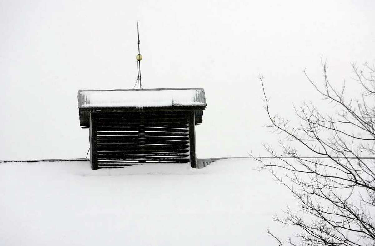 Snow covers the top of a barn in the Hill Country near Fredericksburg in February 2010. The Hill Country could get light snowfall Christmas Eve morning thanks to a cold front moving through the area tonight and into Saturday morning.