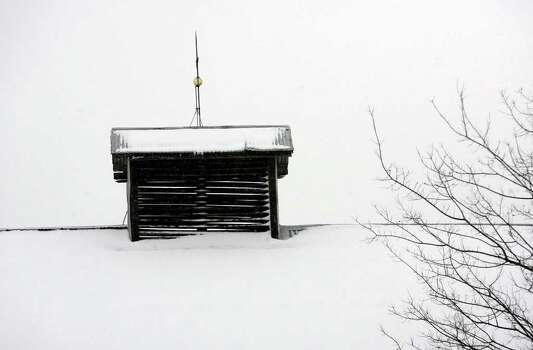 Snow covers the top of a barn in the Hill Country near Fredericksburg in February 2010. The Hill Country could get light snowfall Christmas Eve morning thanks to a cold front moving through the area tonight and into Saturday morning. Photo: TOM REEL, SAN ANTONIO EXPRESS-NEWS  / treel@express-news.net