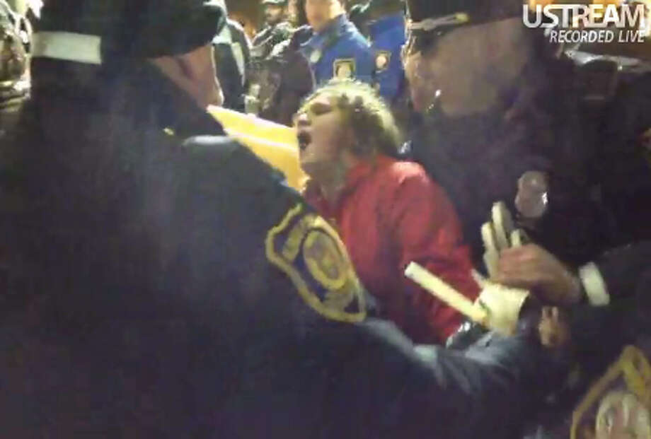 In this screenshot from video taken by Tim Pool, an unidentified protester is seen being physically removed by Albany police from holding onto the last remaining tent at the Occupy Albany site in the city's Academy Park on Thursday, Dec. 22, 2011.