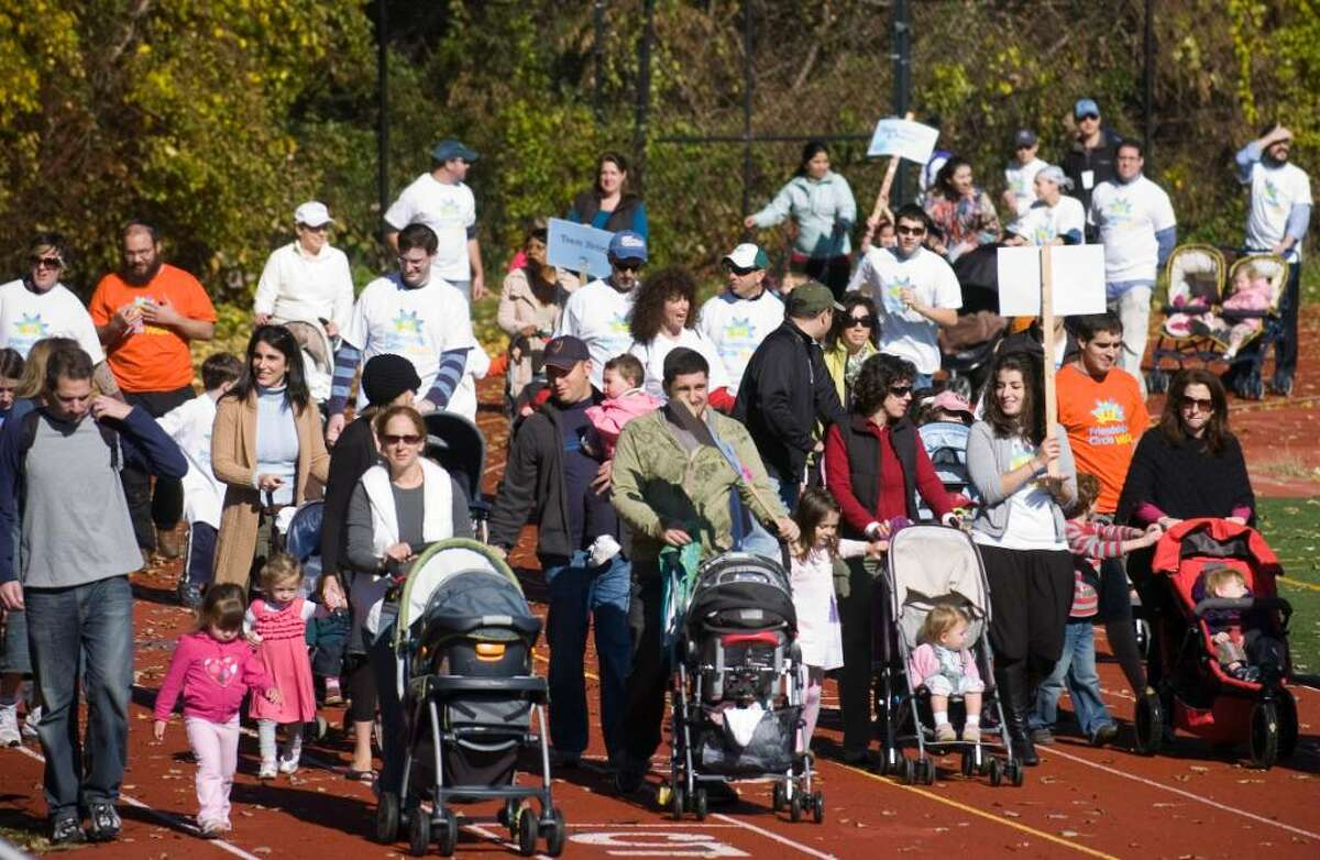 Supports make laps around the track during the Friendship Circle's Frienship Walk, which raised over $110,000 at Westhill High School in Stamford, Conn. on Sunday, Oct. 25, 2009.