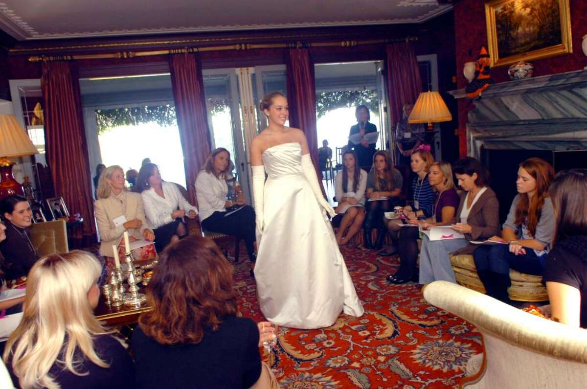 Belle Haven, OCt. 25, 2009. Alex Paradise, 16, from Greenwich High School models a cotillion gown for prospective Junior League Greenwich cotillion debutants and their mothers in a private home.