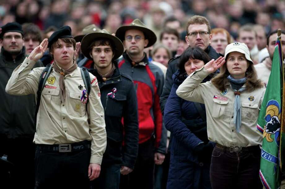 Scouts salute as the hearse go past after the funeral service for former Czech president Vaclav Havel in Prague on December 23, 2011. Havel, a dissident and playwright who was the hero of the 1989 Velvet Revolution against communist rule and became his country's first post-independence president, died on December 18, aged 75. World leaders joined Czech dignitaries to pay homage to Havel at his state funeral in the historic Prague cathedral. AFP PHOTO / ODD ANDERSEN Photo: ODD ANDERSEN, Getty / AFP
