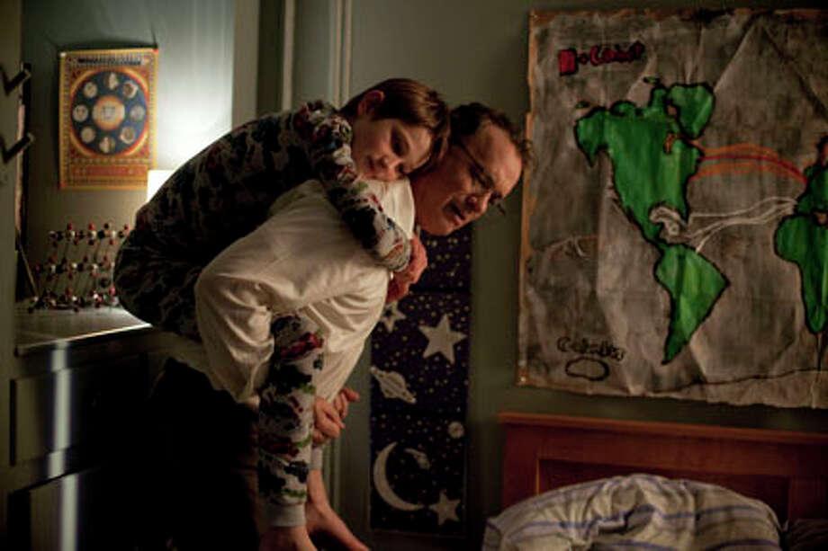 "(L-R) Thomas Horn as Oskar and Tom Hanks in ""Extremely Loud & Incredibly Close."" Photo: Francois Duhamel / ©2011 Warner Bros. Entertainment Inc."
