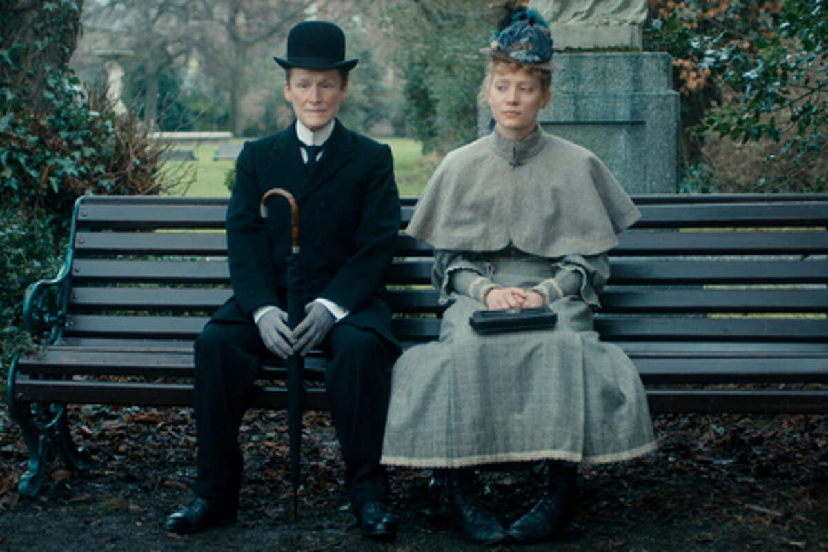 Glenn Close as Albert Nobbs and Mia Wasikowska as Helen in