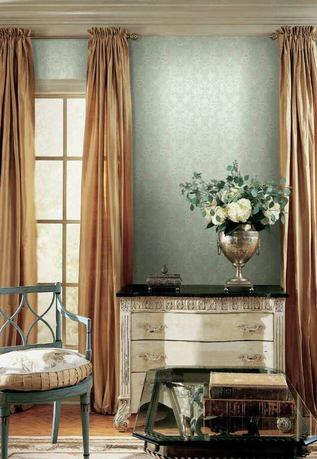 Lace is making its way back into homes as a decor trend this fall. (AP Photo/York Wallcoverings)