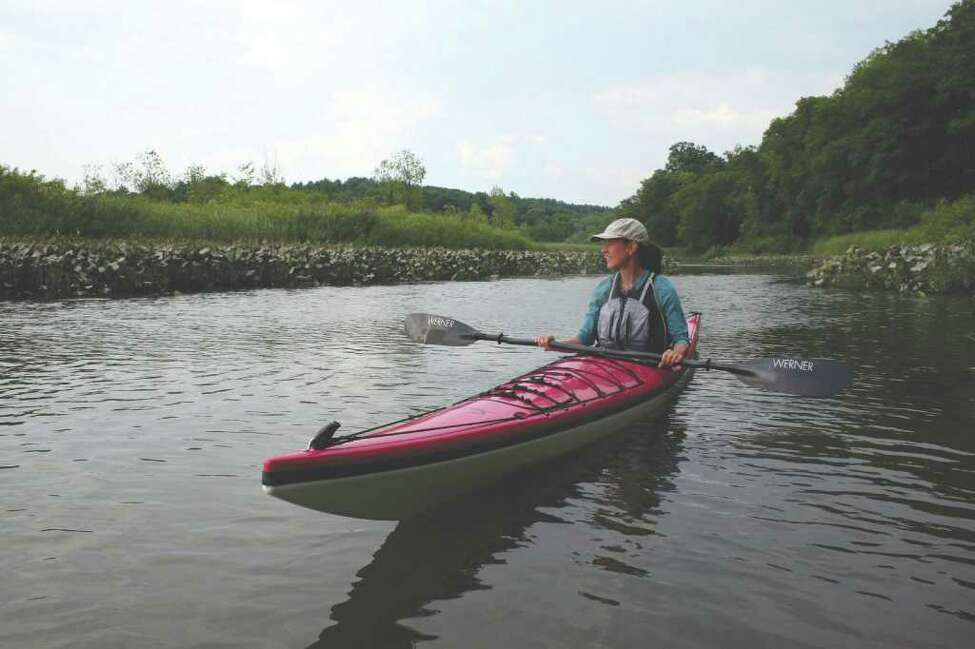 Susan Fox Rogers and her kayak on the Hudson River.