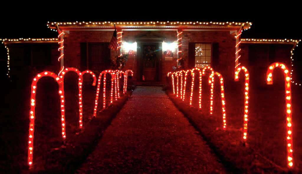 Lighting up the night beaumont enterprise a home in nederland has candy canes lighting up the walkway saturday december 17 mozeypictures Gallery