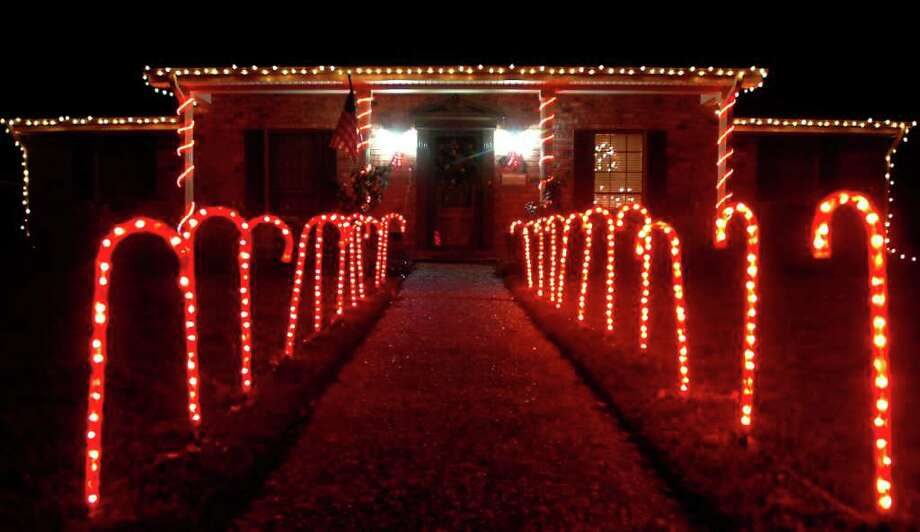 A home in Nederland has candy canes lighting up the walkway Saturday, December 17,  2011. Tammy McKinley/The Enterprise Photo: TAMMY MCKINLEY
