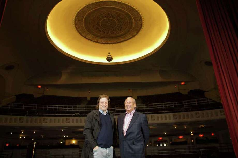 Peter Shapiro, an owner of the Brooklyn Bowl in New York, left, with Marvin Ravikoff, owner of the Capitol Theater, at the theater in Port Chester, N.Y., Dec. 13, 2011. The Cap, as it is known, is a venue where acts like Traffic, Santana and Janis Joplin played in the 1970s, but it has seen a decline in usage recently. Starting this spring, Shapiro will produce about 100 performances a year in the theater. (Andrew Sullivan/The New York Times) Photo: ANDREW SULLIVAN / NYTNS
