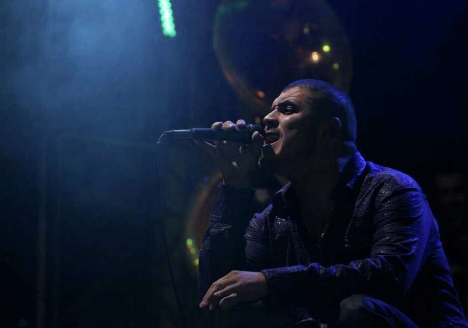 """In this photo taken Saturday Oct. 22, 2011, singer Alfredo Rios known as """"Komander"""" performs in concert at a rodeo in Naucalpan, Mexico.  Rios is the king of Movimiento Alterado, a new style of  'Narcocorridos,' or drug ballads, in which the performer sings as if he were a member of a drug cartel, instead of just glamorizing the world of drug trafficking. (AP Photo/Marco Ugarte) Photo: Marco Ugarte / AP"""