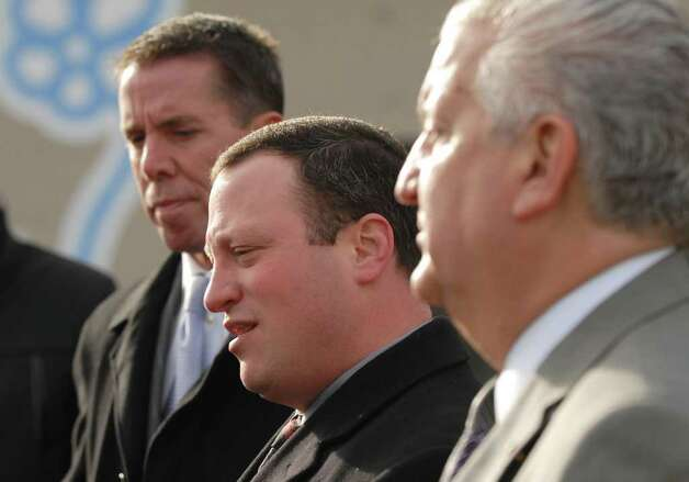 Albany police chief Steven krokoff, center, comments on Thursday night?s police action against the Occupy Albany group in Albany, during a press conference Friday morning in Albany, N.Y. Dec. 23, 2011. Chief Krokoff is flanked by Stephen Rehfuss an attorney representing the city,, left, and Mayor Jerry Jennings, right. (Will Waldron / Times Union) Photo: Will Waldron