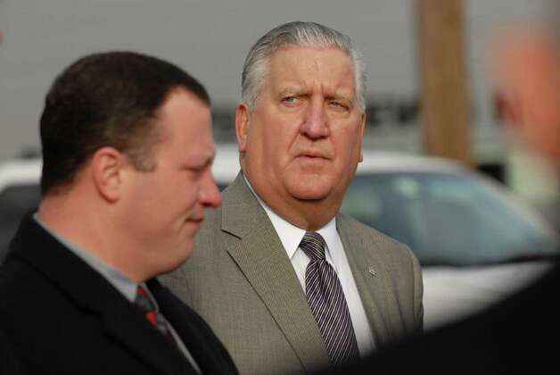 Mayor Jerry Jennings, right, listens to Chief Steven Krokoff, left, during a  on a press conference Friday morning in Albany, N.Y. Dec. 23, 2011, to discuss Thursday night?s police action against the Occupy Albany group. (Will Waldron / Times Union) Photo: Will Waldron