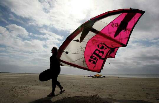 Guests to South Padre Island can take advantage of the small, but surfable waves. Other activities include helicopter tours, birding, horseback riding and eco-tours. Island promoters are hoping to lure more families to the area during spring break. Photo: EDWARD A. ORNELAS / San Antonio Express-News