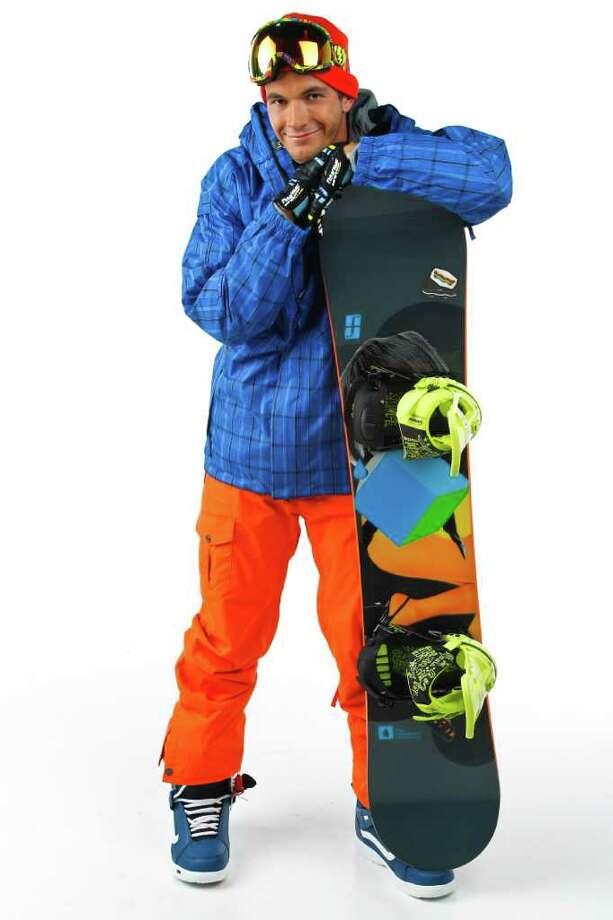 Alexander Zinchenko wears Vans Hi Standard Boots, $169.99; Dakine gloves, $17.43; Youngblood 156 Double Dog snow board, $399.99; Burton long-sleeve top, $59.95; 686 Smarty blue jacket, $290; 6868 Smarty orange pants, $130; EG2 goggles, $160; Oakley hat, $12.53; all from Sun & Ski Sports. Photo: Michael Paulsen / © 2011 Houston Chronicle