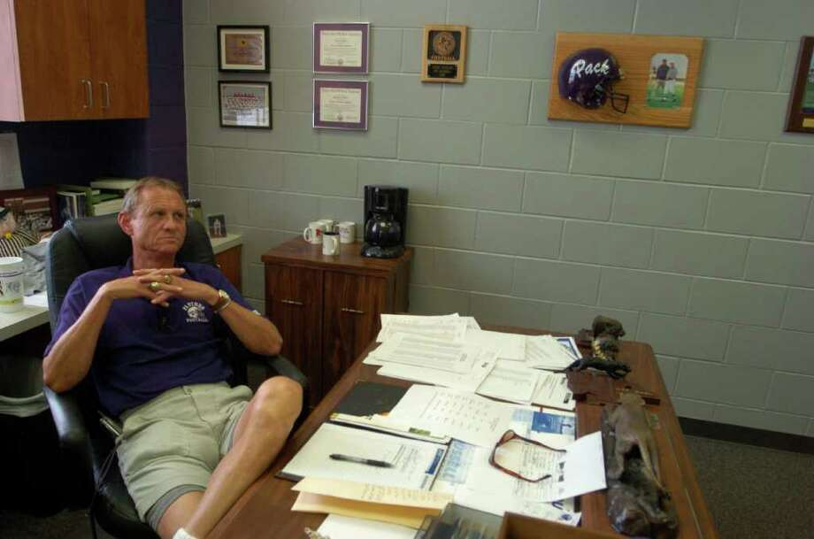 Lufkin High School football coach John Outlaw sits in his office before practice on Sept. 30, 2005. Photo: Johnny Hanson, Houston Chronicle / Contract