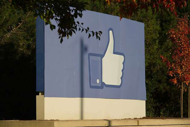 "The Facebook Inc. thumbs-up ""Like"" icon is displayed on a sign at the company's new campus in Menlo Park, California, U.S., on Friday, Dec. 2, 2011. Facebook hopes to accommodate over 6,000 employees on the new campus, which will spread out over a million square feet of office space when completed in mid-December 2011. Photographer: David Paul Morris/Bloomberg Photo: David Paul Morris, Bloomberg"