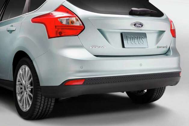the 2012 Ford Focus Electric hatchback is similar in size to the battery-operated Nissan Leaf, but is designed to recharge its battery in half the time as it takes for the Leaf. Photo: Ford Motor Co., Wieck / Ford
