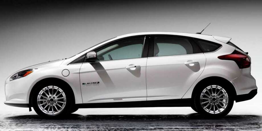 Base price for the 2012 Ford Focus Electric hatchback is $39,995, the same as that of the Chevrolet Volt plug-in hybrid car but nearly $5,000 more than that of the comparable Nissan Leaf electric model. Photo: Ford Motor Co., Wieck / Ford