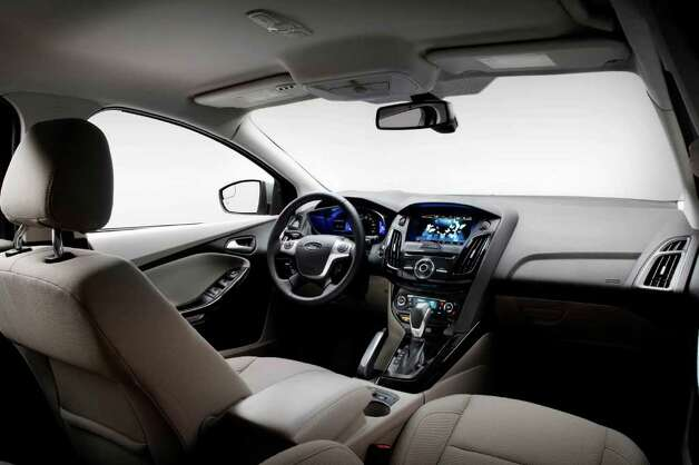 The Ford Focus Electric has such standard features as six air bags and electronic traction control, along with hands-free telephone connectivity and navigation. Photo: Ford Motor Co., Wieck / Ford