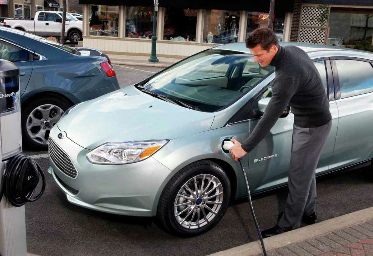 The charging port for the 2012 Ford Focus Electric hatchback is in a front fender in about the same spot as the gasoline-tank filler tube for Chevrolet's 1960s-era, rear-engine Corvair. The difference: no gas-guzzling.