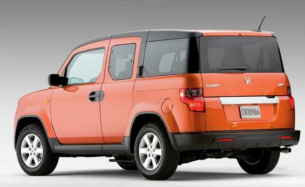 The Honda Element seats four and comes with such extras as four-wheel drive and a rubber floor that can be hosed out easily. Photo: Courtesy Of American Honda Motor, Wieck / Honda