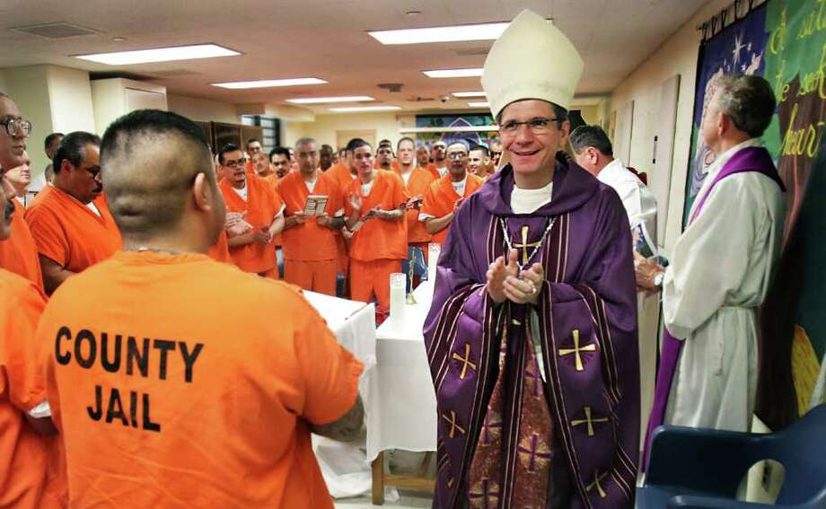 San Antonio Archbishop Gustavo Garcia-Siller celebrates Mass inside Bexar County Jail, as a way of ministering to inmates unable to attend a service with their families.  Friday, Dec. 23, 2011. Photo: BOB OWEN, SAN ANTONIO EXPRESS-NEWS / rowen@express-news.net
