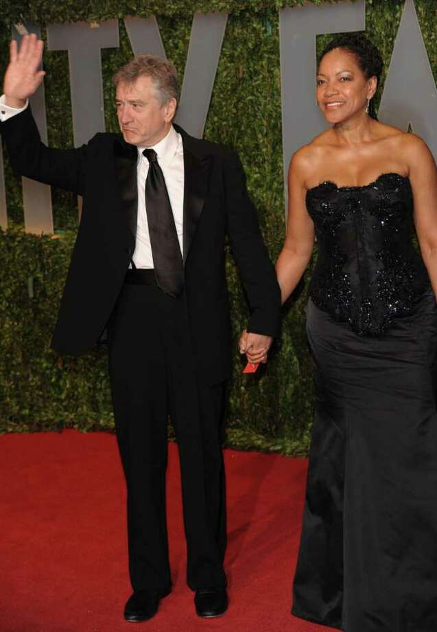 FILE-   In this Sunday, Feb. 22, 2009 file photo, Robert DeNiro and Grace Hightower arrive at the Vanity Fair Oscar party in West Hollywood, Calif. (AP Photo/Evan Agostini, FILE) Photo: Evan Agostini