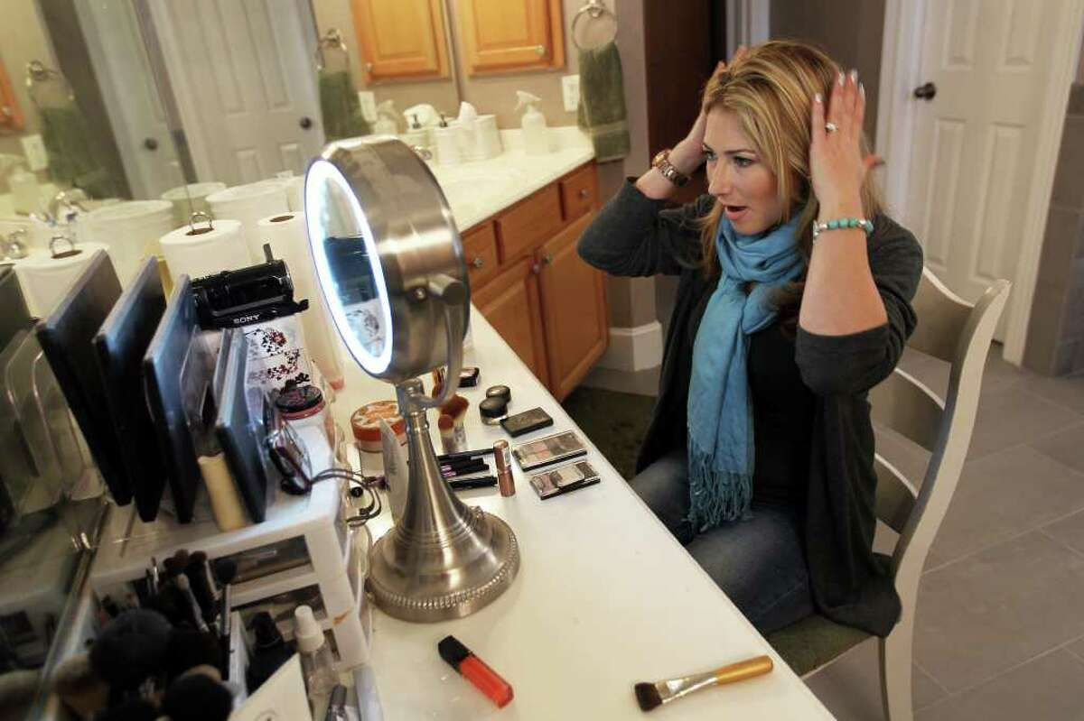 """Marnie Goldberg, known on YouTube as """"MsGoldGirl,"""" makes her """"December Favorites"""" video highlighting makeup and beauty products in the bathroom of her San Antonio home."""
