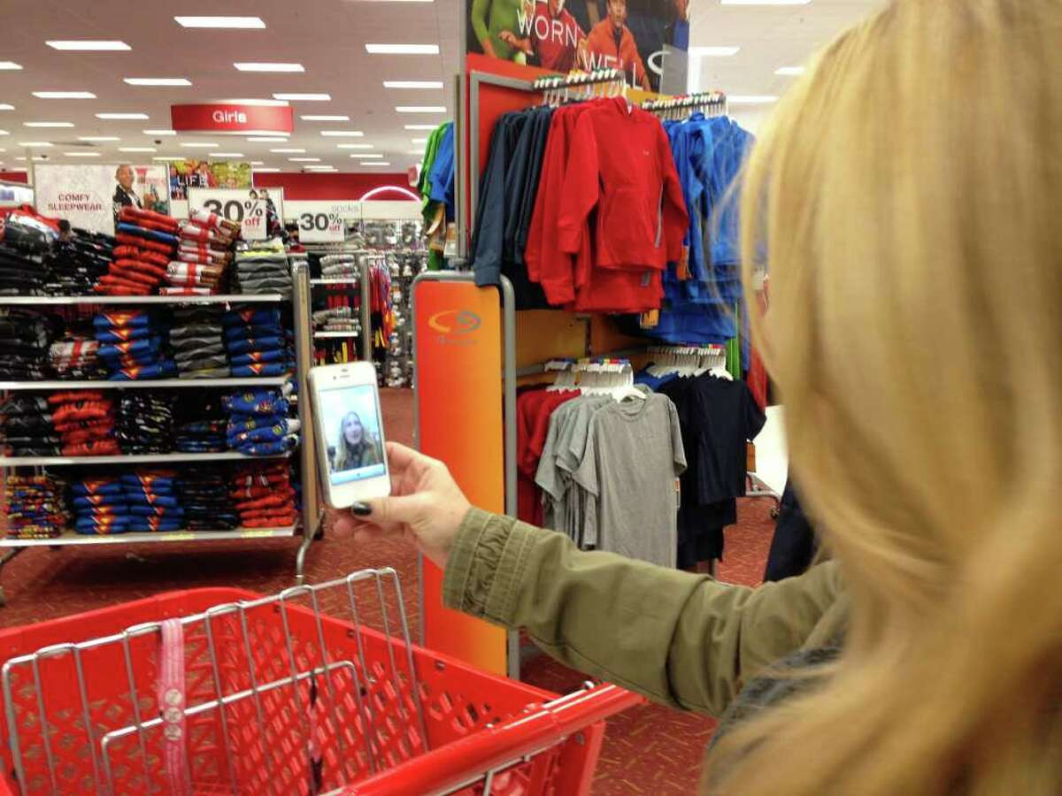 Marnie Goldberg uses her iPhone to make a video of herself Christmas shopping in Target.
