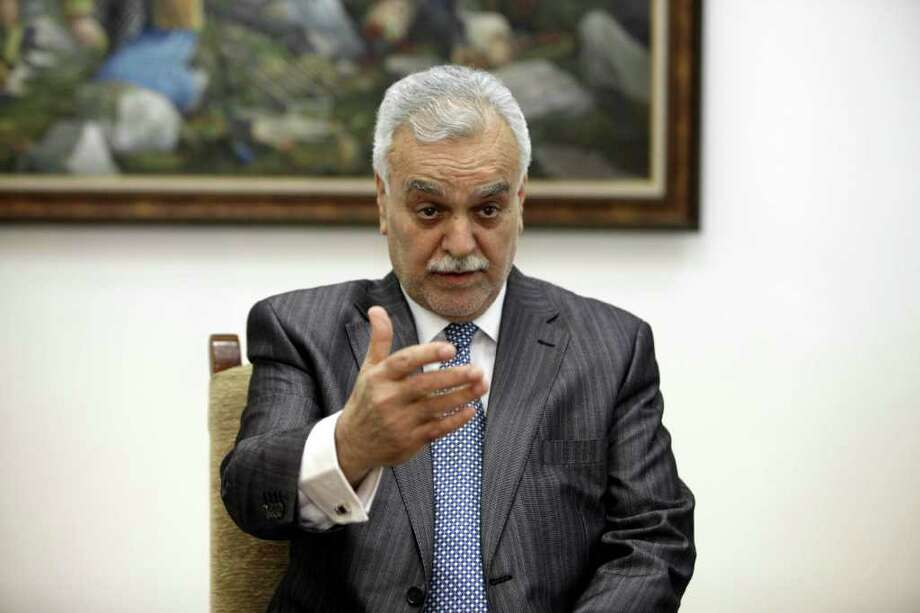 "Iraq's Sunni Vice President Tariq al-Hashemi speaks during an interview with The Associated Press near Sulaimaniyah, 160 miles (260 kilometers) northeast of Baghdad, Iraq, Friday, Dec. 23, 2011. The Sunni vice president wanted for allegedly running a hit squad in Iraq accuses Shiite Prime Minister Nouri al-Maliki of waging a campaign against Sunnis and brewing a sectarian war. In an interview with The Associated Press, Tariq al-Hashemi said al-Maliki wants to get rid of all political rivals and run Iraq like a ""one-man-show.""(AP Photo/Karim Kadim) Photo: Karim Kadim / AP"