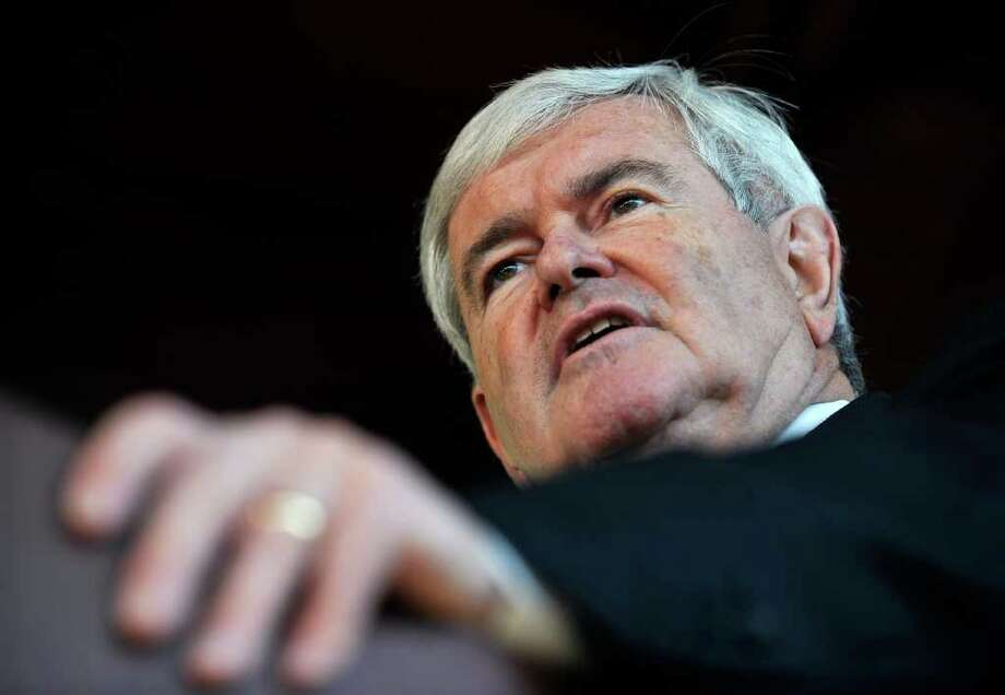 Republican presidential candidate former House Speaker Newt Gingrich speaks during a campaign stop, Friday, Dec. 23, 2011, in Columbia, S.C.  (AP Photo/Rainier Ehrhardt) Photo: Rainier Ehrhardt / FR155191 AP