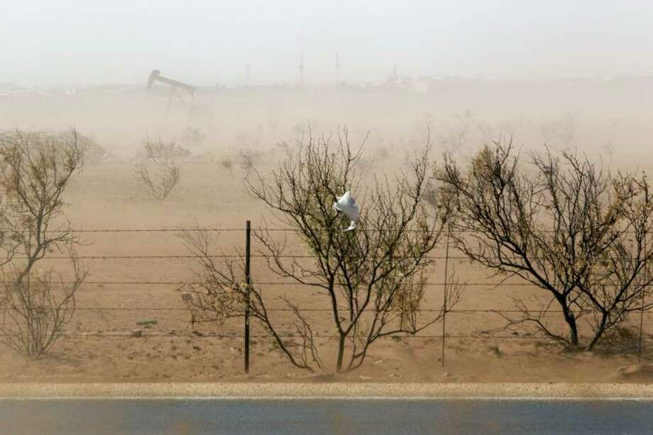 June 1, 2011 | Wind kicks up dust, intensified by the drought, obscuring a pump jack in Midland. Photo: Brett Coomer, Houston Chronicle / © 2011 Houston Chronicle
