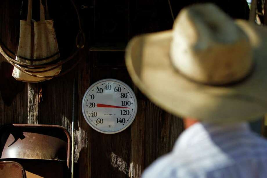 Aug. 9, 2011 | Bobby Blaylock, County Commisioner and rancher, looks at his thermometer reading 110 degrees in the shade at his ranch home in Robert Lee. The city of Robert Lee is experiencing an unprecedented drought after only receiving around 3 inches of rain in the past year. Photo: Michael Paulsen, Houston Chronicle / © 2011 Houston Chronicle