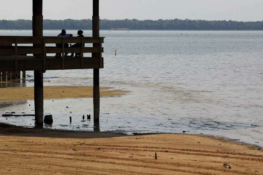 Aug. 27, 2011 | Visitors take to the shade of a gazebo over dwindling water at Alexander Deussen Park on Lake Houston in Houston. Saturday's high temperature topped out at 109 degrees tying the record high temperature for the city and making it the hottest day in a summer of already record breaking heat. Photo: Smiley N. Pool, Houston Chronicle / © 2011  Houston Chronicle