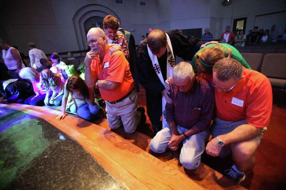 Sept. 11, 2011 | The congregation prays together during Sunday Service at Wildwood United Methodist Church as it observes the Sept. 11th attacks anniversary and pray for fire victims in the tri-county wildfires. Photo: Mayra Beltran, Houston Chronicle / © 2011 Houston Chronicle